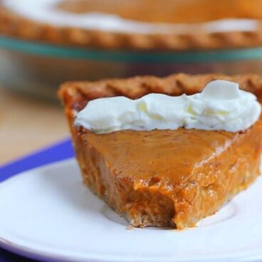 Creamy, smooth, melt-in-your-mouth sweet potato pie… This is my family's favorite recipe - traditional sweet potato pie with a light and flaky pie crust that makes this a staple recipe every year at our Thanksgiving table. You WON'T miss the pumpkin pie at all! https://chocolatecoveredkatie.com @choccoveredkt
