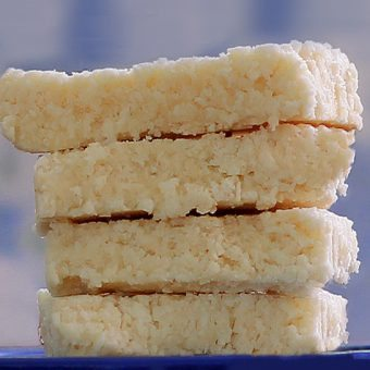 COCONUT CRACK BARS - 1 cup shredded coconut, 1/2 tsp vanilla extract, 1/8 tsp salt, 1/4 cup... Full recipe: https://chocolatecoveredkatie.com/2012/08/30/no-bake-coconut-crack-bars/ @choccoveredkt