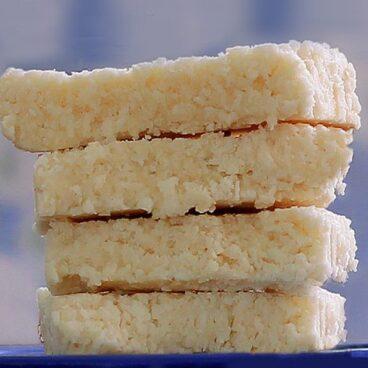 COCONUT CRACK BARS - 1 cup shredded coconut, 1/2 tsp vanilla extract, 1/8 tsp salt, 1/4 cup... Full recipe: https://chocolatecoveredkatie.com/2012/08/30/no-bake-coconut-crack-bars/ @choccoveredkt