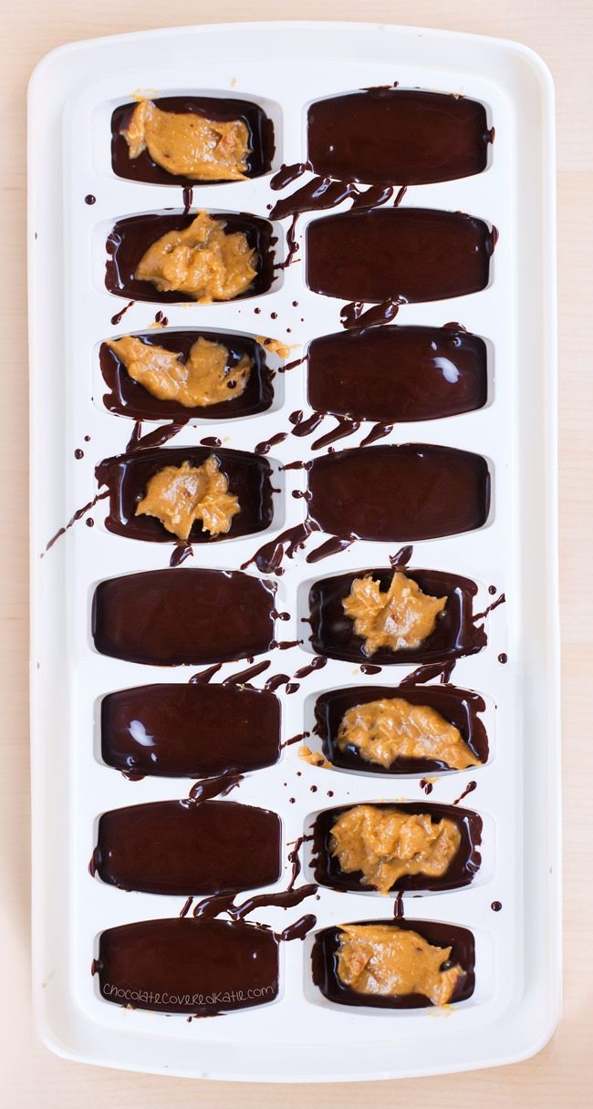 "Homemade ""5 minute"" chocolate peanut butter cups, made with an ice cube tray for whenever a craving hits ... http://chocolatecoveredkatie.com/2016/02/29/ice-cube-tray-chocolate-peanut-butter-cups-recipe/ @choccoveredkt"