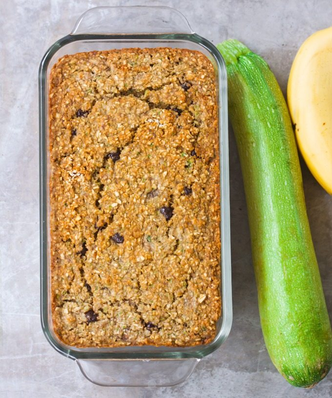Zucchini Banana Bread – Deliciously soft homemade banana bread, with gooey chocolate chips in each bite... The zucchini adds incredible moisture, without all the fat! @choccoveredkt http://chocolatecoveredkatie.com