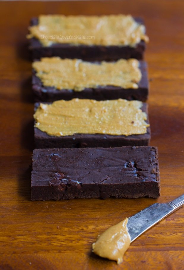 NO flour, NO refined sugar chocolate protein bars - tastes like eating a Reeses Peanut Butter Cup... but GOOD for you!!! - https://chocolatecoveredkatie.com/2016/01/06/homemade-protein-bars-chocolate-peanut-butter-vegan/ @choccoveredkt