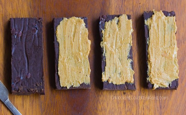 Homemade Protein Bars - Avoid the unhealthy processed ingredients by making your own HEALTHY chocolate protein bars at home - These bars taste like a Reeses peanut butter cup!!! https://chocolatecoveredkatie.com/2016/01/06/homemade-protein-bars-chocolate-peanut-butter-vegan/ @choccoveredkt