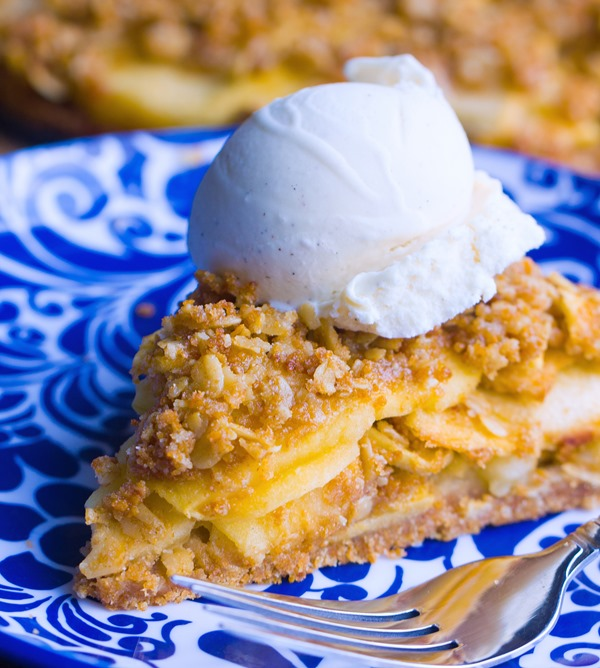 Flaky homemade pie crust, sweet cinnamon apples, and buttery oatmeal crumble – This homestyle Dutch apple pie is good beyond words! https://chocolatecoveredkatie.com/ @choccoveredkt