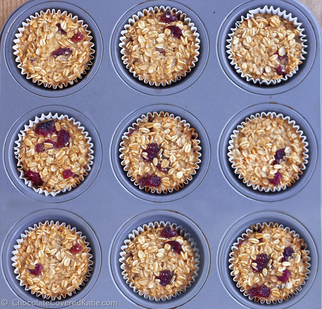 """Featured by Fitness Magazine - customizable """"breakfast"""" oatmeal cupcakes from @choccoveredkt, Great on-the-go fuel on rushed mornings + Can be frozen for later. Full recipe: https://chocolatecoveredkatie.com/2015/01/08/go-breakfast-oatmeal-trail-mix-cupcakes/"""