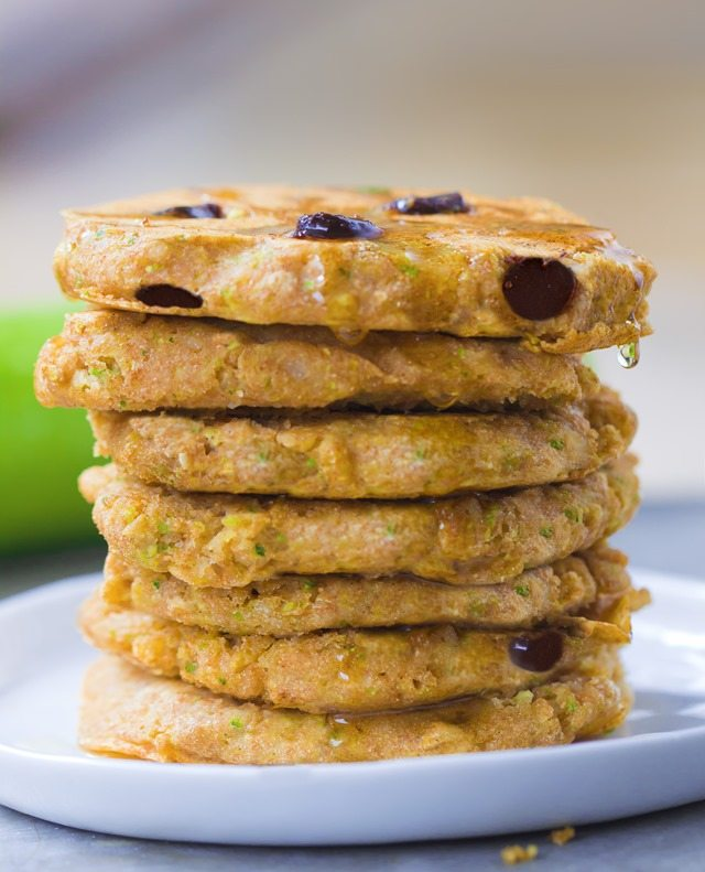 A giant stack of extra fluffy zucchini pancakes, stuffed with melty gooey chocolate chips - These disappear so quickly whenever I make them: https://chocolatecoveredkatie.com/2015/08/10/zucchini-pancakes-healthy-vegan/